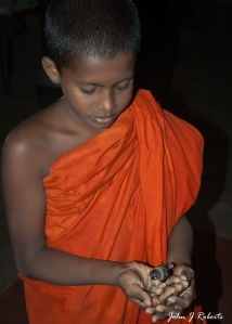 6 Aug 2010  Nalaka found a wounded bird and was nursing it back to health. He was a little bit more mischievous than this somewhat cherubic photo implies.  Sri Wewekarama, Godagama, Sri Lanka